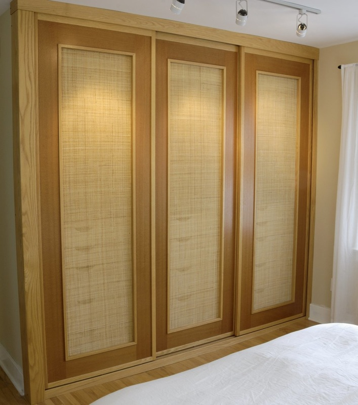 Sliding Closet Doors In Red Oak, Australian Lacewood With Woven Cane Panels.